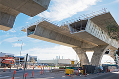 Image of a nearly completed concrete bridge
