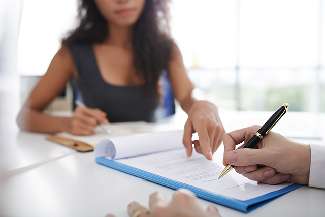 Woman pointing at a contract.