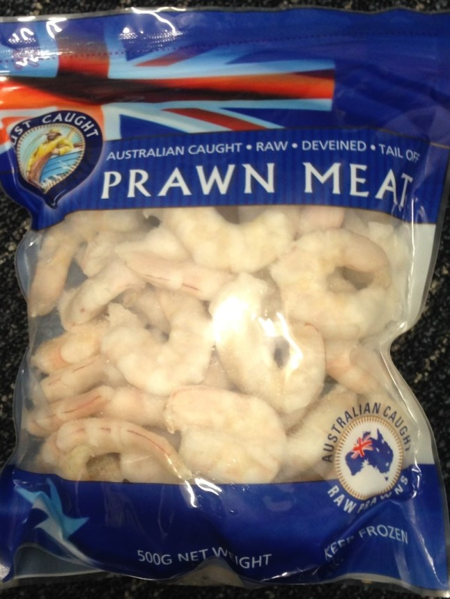 The words 'Australian Caught - Raw - Deveined - Tail Off - Prawn Meat' are displayed on the packet.