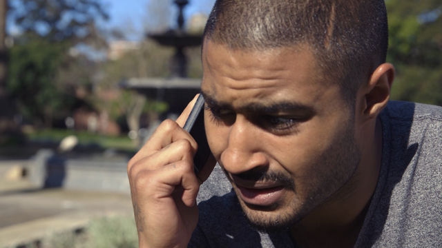 Young man talking on a mobile phone.