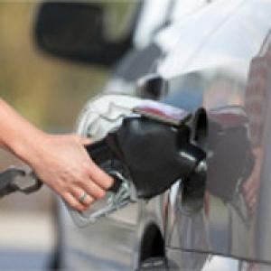 Person filling up petrol tank