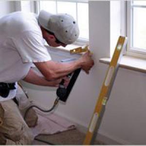 Repairman fixing window
