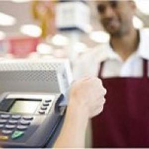 Customer swiping card at cash register
