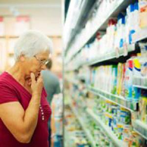 Woman looking at products in supermarket