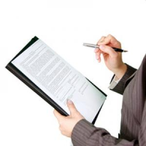 Businessperson holding clipboard and pen