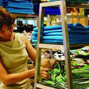 Woman browsing fabric at shop
