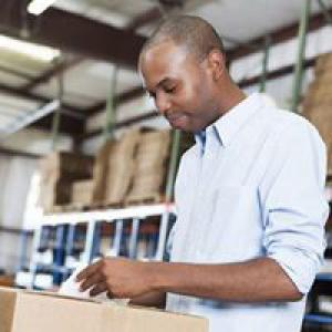 Man looking at label on box