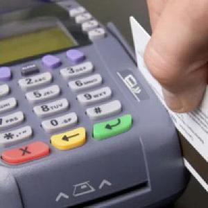 Customer swiping card through EFTPOS machine