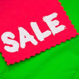 Red sale tag on green background