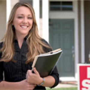 Real estate agent outside of house
