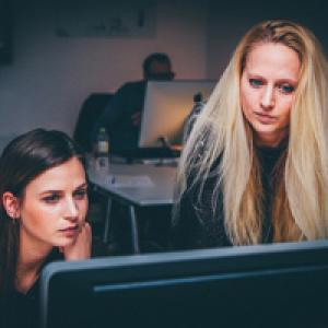 Two women looking concerned at computer