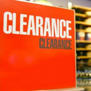 Red clearance sign in shop