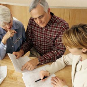 Salesperson talking to elderly couple