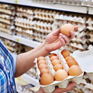 Person looking at eggs in supermarket