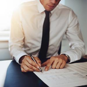 Man writing on paperwork