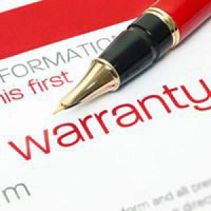 Warranties paperwork and pen