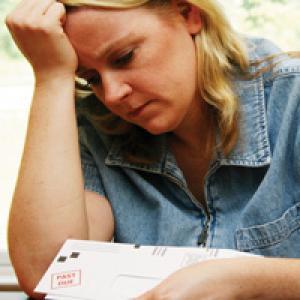 Woman loking sadly at mail